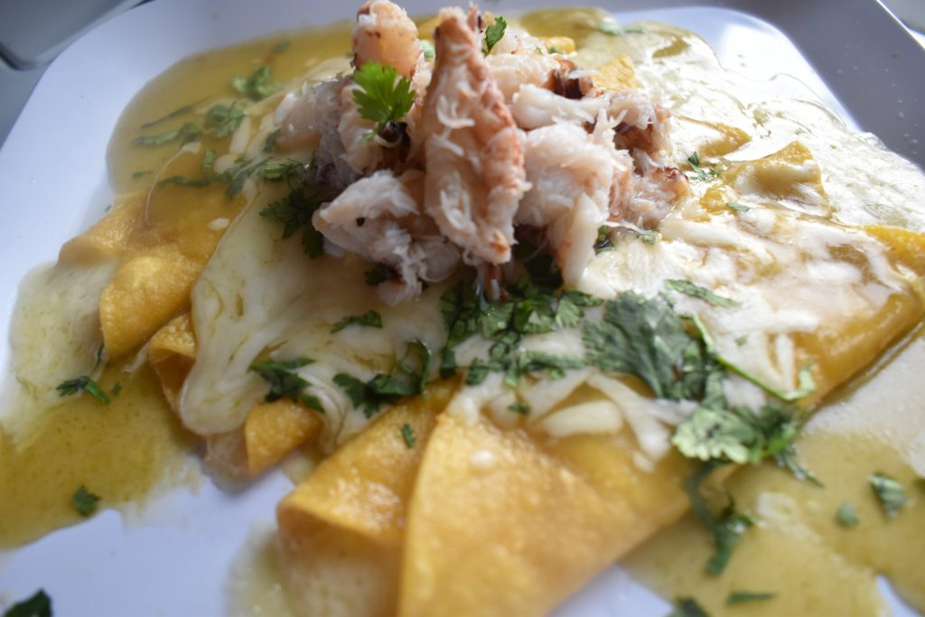 Rich and creamy rolled corn tacos with Dungeness crab piled high