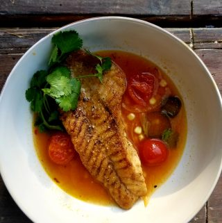 Lightly coated snapper in a spicy tomato broth