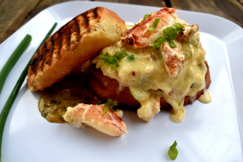 Rich, buttery Dungeness crab, sharp white cheddar and fire roasted tomatillo on a grilled sourdough toast.