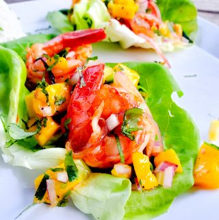 Bite size lettuce wraps with mango chile shrimp and mango salsa