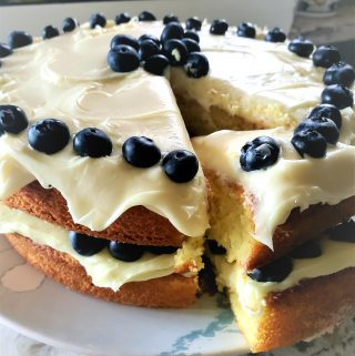 This Lemon Blueberry Cake is a favorite at our house. Perfect for summer grilling parties with it's bright lemon filling, whipped cream cheese frosting and fresh Driscoll's blueberries.