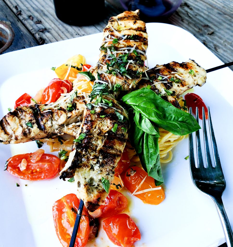 Quick & Easy Grilled Chicken Pesto Kabobs pair perfectly with summery blistered tomato spaghetti.
