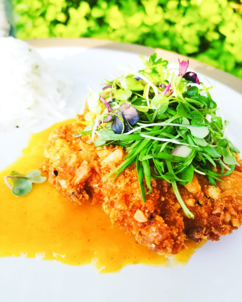 Buttery Macadamia nuts coat this Pacific Red Snapper for a sweet and nutty crunch that pairs perfectly with a slightly smoky mango sauce. Micro greens that are dressed in a mango vinaigrette add that needed freshness to take this meal to fine dining status.