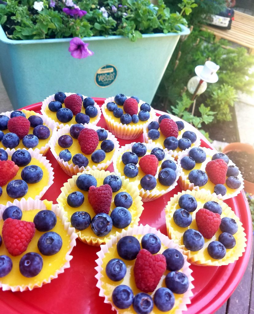 Sweet and tart lemon curd in a graham cracker crust with fresh blueberries and raspberries