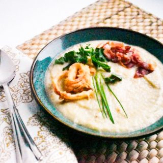 Roasting parsnips brings out their earthy sweet flavor in this winter soup. Not only is this soup easy to make, it's easy on the budget too.