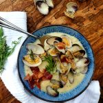 This rustic, Farm Style Clam Chowder combines fresh manila clams, sliced baby potatoes, a splash of sherry, cream, tarragon and smokey bacon.