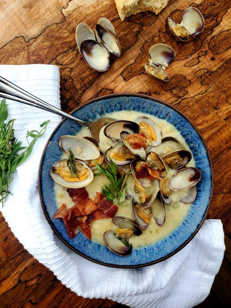 This rustic, Farm Style Clam Chowder combines fresh manila clams, sliced baby potatoes, a splash of sherry, cream, tarragon and smokey bacon.