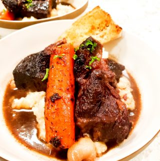Tender, fall apart, beef chuck braised in rich port wine with carrots and pearl onions over creamy mashed potatoes