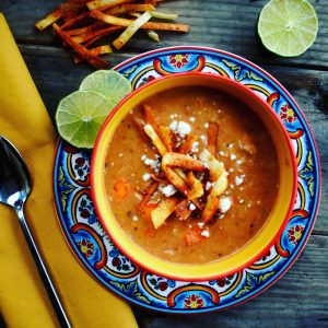 Charro Frijoles are creamy pinto beans are cooked with bacon and chorizo to get that smokey, spicy flavor and a mirapoix of celery, carrot and onion add a richness. Topped with crumbed cotija and crispy fried tortilla strips, you've got a family friendly meal in a bowl.