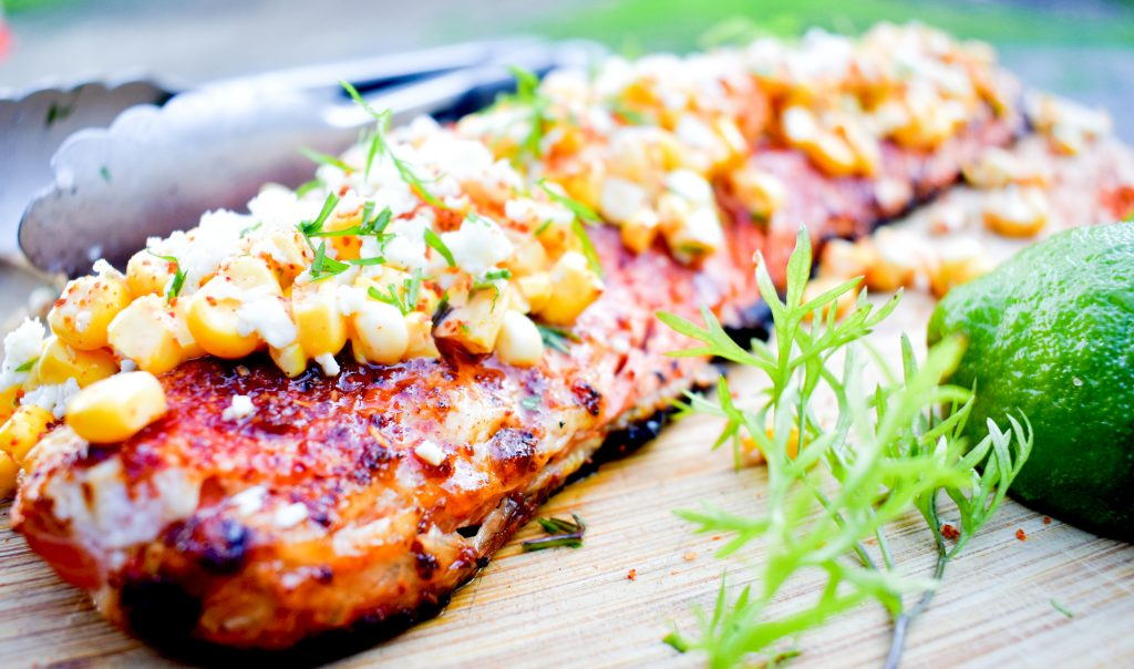 Grilled salmon with fresh corn, cilantro and cotija cheese