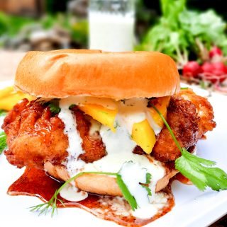 Hot chicken sandwich, creamy jalapeno sauce and fresh mango