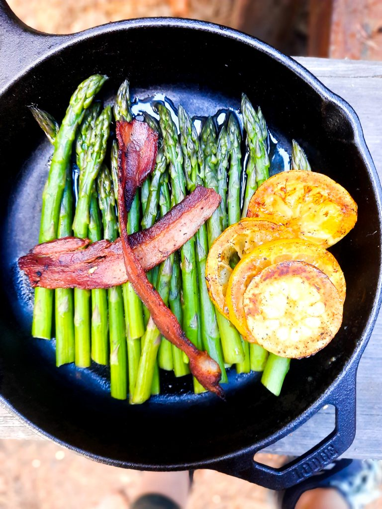 Steamed asparagus with bacon and charred lemon