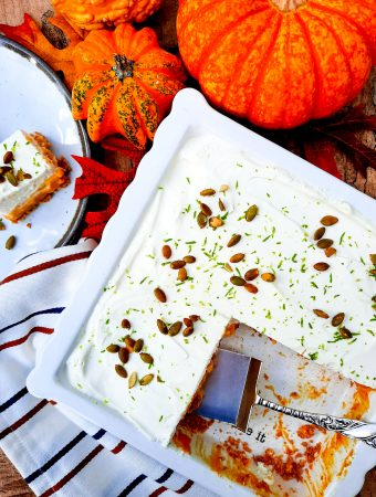Pumpkin Cream Bars with Chili Lime Pepitas combines the flavors of traditional pumpkin pie with lime zested whipped cream topping and chili lime pepitas in a graham cracker crust.