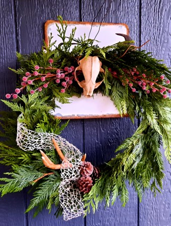 DIY Christmas wreath made from cedar boughs and craft items