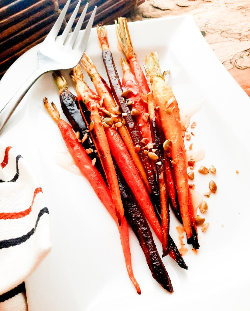 An easy side dish full of flavor, Roasted Spiced Carrots with Agave and Pepitas bring rustic elegance to your table.