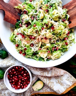 Shallot lemon vinaigrette drizzled over this Shaved Brussels Sprouts Salad with grated parmesan, pomegranate and toasted bread crumbs.