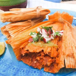 Freshly made Red Chili Tamales are tender and flavorful with diced radish and cilantro