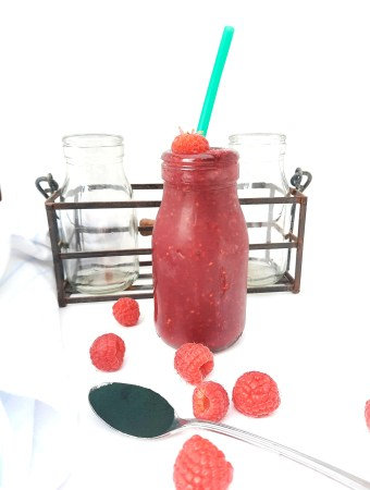 Spirulina Pomegranate Raspberry Smoothie combines three powerful anti-oxidants along with vitamins and minerals for a healthy drink.