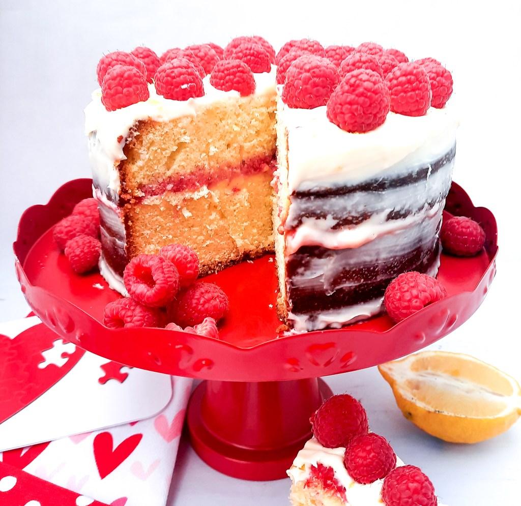 Fresh Raspberry Lemonade Pound Cake, raspberry and lemon cream between buttery lemon pound cake with lemon cream frosting fresh raspberries.