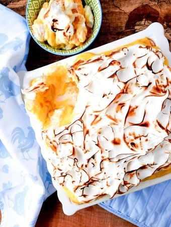 This No Bake Banana Dream Dessert combines layers of lady fingers, bananas, vanilla pudding, whipped cream and it's topped with toasted meringue.