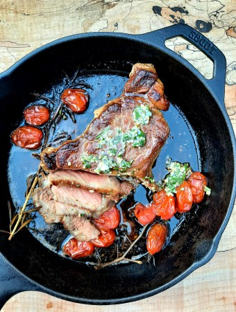 Cast iron seared Rib Steak with Chive Butter and sweet vine tomatoes