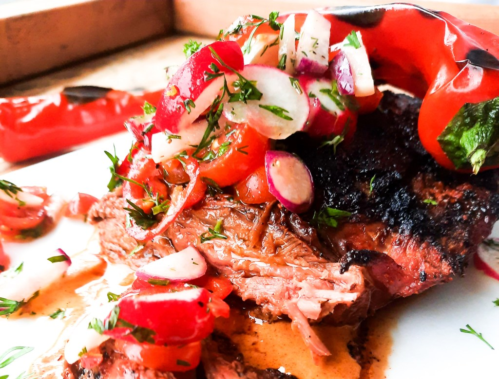 Grilled Bavette Steak with Smoked Paprika Sauce has a spicy seasoned crust and a juicy tender inside with fresh tomato radish salad.