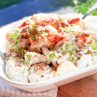 Spicy Dill Pickle Potato Salad with Bacon combines new potatoes with creamy dill dressing, Fresno chilies and my favorite spicy dill pickles.