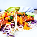 Nearly guilt free, these Grilled Pacific Rock Fish Tacos skip the typical dredging and go straight for the grill. Topped with fresh mango salsa and served in a warm flour tortilla with chipotle slaw.