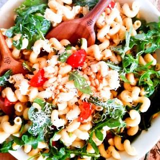 Out West's Lemon Arugula Pasta Salad combines cellentani pasta, arugula, pine nuts and cherry tomatoes in a light lemon vinaigrette dressing.