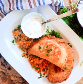 Chorizo-Corn Empanadas are savory hand pies made with a masa harina flour blend and filled with cheese, spicy ground chorizo and sweet corn.
