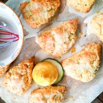 Bright and Citrusy Lemon Zucchini Scones are made bakery style with plenty of shredded zucchini and a sweet lemon zest glaze.