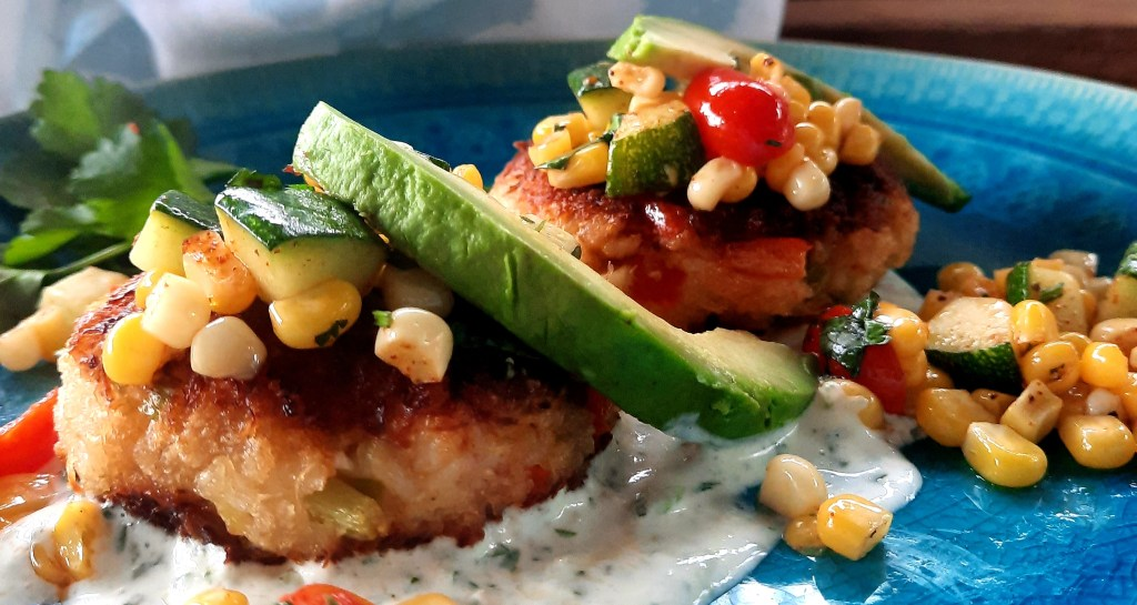 Mexican Crab Cakes with Serrano Cream use rich, buttery, Dungeness crab and just enough Panko with a creamy serrano cilantro lime sauce.